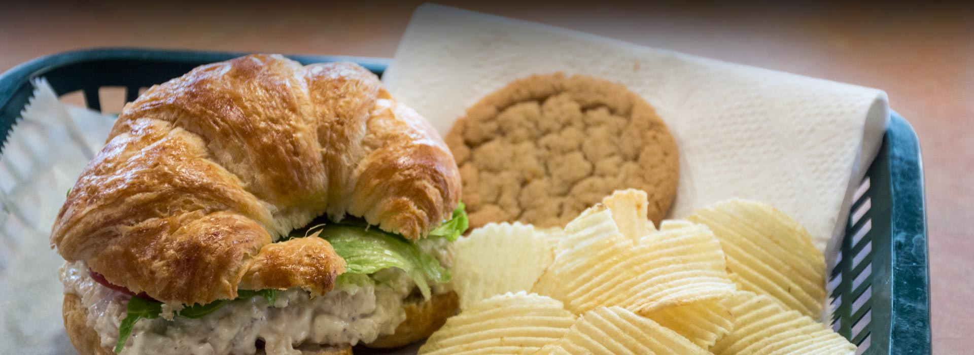 chicken salad croissant and potato chips